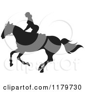 Clipart Of A Silhouetted Woman Horseback Riding Royalty Free Vector Illustration