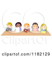 Cartoon Of Diverse School Children Sitting At A Shared Desk Royalty Free Vector Clipart