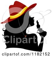 Cartoon Of A Silhouetted Cowgirl Wearing A Red Hat And Blowing Heart Smoke From A Gun Royalty Free Vector Clipart