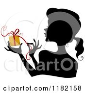 Cartoon Of A Black Silhouetted Woman Holding And Opening A Yellow Gift Royalty Free Vector Clipart