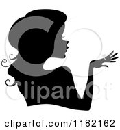 Cartoon Of A Black Silhouetted Woman Showing Her Diamond Ring Royalty Free Vector Clipart by BNP Design Studio
