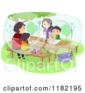 Cartoon Of A Happy Family Coloring On A Picnic Table Royalty Free Vector Clipart