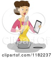 Brunette Woman Refering A To A Tablet For A Recipe