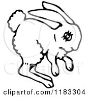 Clipart Of A Black And White Hopping Bunny Royalty Free Vector Illustration by Prawny