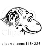 Clipart Of A Black And White Monkey Face In Profile Royalty Free Vector Illustration
