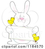 Happy White Easter Bunny Holding A Sign With Two Chicks
