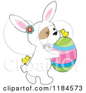 Cartoon Of A Cute Puppy Wearing A Bunny Costume And Carrying An Easter Egg With Chicks Royalty Free Vector Clipart