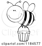 Cartoon Of A Happy Black And White Bee With A Honey Bucket Royalty Free Vector Clipart by Hit Toon