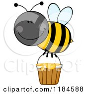 Cartoon Of A Happy Bumble Bee With A Honey Bucket Royalty Free Vector Clipart by Hit Toon