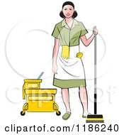 Janitorial Woman In A Green Uniform Standing By A Mop Bucket