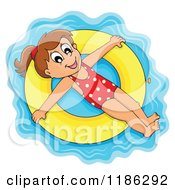 Cartoon Of A Happy Girl Floating On An Inner Tube Royalty Free Vector Clipart