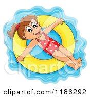 Happy Girl Floating On An Inner Tube