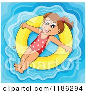 Cartoon Of A Happy Girl Floating On A Yellow Inner Tube Royalty Free Vector Clipart