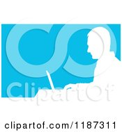 Cartoon Of A White Silhouetted Man Working On A Laptop At A Desk Over Blue Royalty Free Vector Clipart
