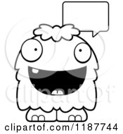 Cartoon Of A Black And White Talking Furry Monster Royalty Free Vector Clipart