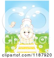 Cartoon Of A Butterfly Over A Cute Outlined Train On Tracks Surrounded By Daisies Royalty Free Clipart