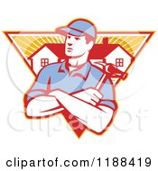 Clipart Of A Retro Home Builder With Folded Arms And A Hammer Over A Triangle Of Houses And Rays Royalty Free Vector Illustration