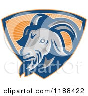 Clipart Of A Retro Goat In A Shield Of Orange Rays Royalty Free Vector Illustration by patrimonio