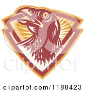 Clipart Of A Retro Hawk In A Shield Of Rays Royalty Free Vector Illustration by patrimonio