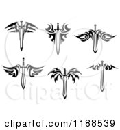 Clipart Of Black And White Tribal Winged Swords Royalty Free Vector Illustration