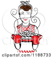 Clipart Of A Retro Brunette Housewife Holding Freshly Baked Cookies Royalty Free Vector Illustration