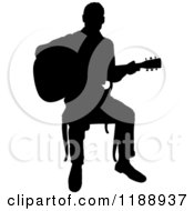 Clipart Of A Black Silhouetted Man Playing A Guitar In A Chair Royalty Free Vector Illustration