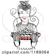 Clipart Of A Retro Happy Gray Haired Housewife Holding Freshly Baked Cookies Royalty Free Vector Illustration