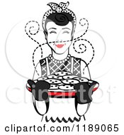 Clipart Of A Retro Happy Black Haired Housewife Holding Freshly Baked Cookies Royalty Free Vector Illustration by Andy Nortnik