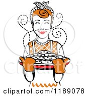 Clipart Of A Retro Happy Redhead Housewife Holding Freshly Baked Cookies Royalty Free Vector Illustration