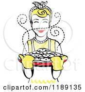 Clipart Of A Retro Happy Blond Housewife Holding Freshly Baked Cookies 2 Royalty Free Vector Illustration by Andy Nortnik