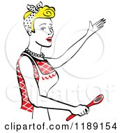 Happy Retro Blond Housewife Singing And Holding A Spoon In The Kitchen