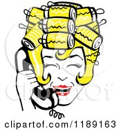 Happy Retro Blond Housewife With Her Hair Up In Curlers Laughing While Talking On A Landline Telephone