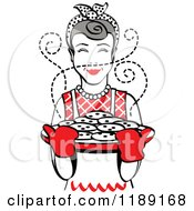 Clipart Of A Retro Happy Gray Haired Housewife Holding Freshly Baked Cookies 2 Royalty Free Vector Illustration by Andy Nortnik