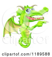 Cartoon Of A Happy Green Dragon Pointing At A Sign Royalty Free Vector Clipart