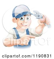 Poster, Art Print Of Happy Brunette Worker Man Holding A Wrench And Pointing
