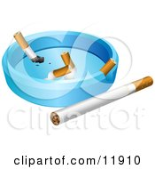 Whole Cigarette By An Ash Tray With Cigarette Butts