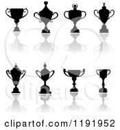 Clipart Of Silhouetted Trophy Cups And Urns And Reflections 3 Royalty Free Vector Illustration