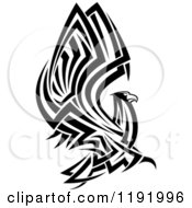 Clipart Of A Black And White Flying Tribal Eagle Falcon Or Hawk Royalty Free Vector Illustration