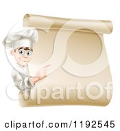 Cartoon Of A Happy Young Male Chef Pointing To A Scroll Menu Sign Royalty Free Vector Clipart