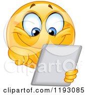 Cartoon Of A Happy Smiley Emoticon Using A Tablet Computer Royalty Free Vector Clipart