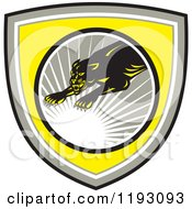 Clipart Of A Leaping Panther In A Gray Circle With A Sun Burst On A Yellow Shield Royalty Free Vector Illustration