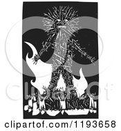 Clipart Of A Crowd Around A Giant Wicker Man Black And White Woodcut Royalty Free Vector Illustration