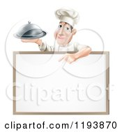 Cartoon Of A Male Chef Holding A Cloche And Pointing Down At A White Board Royalty Free Vector Clipart