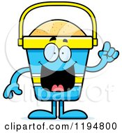 Cartoon Of A Smart Beach Pail Mascot With An Idea Royalty Free Vector Clipart