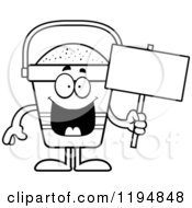 Cartoon Of A Black And White Happy Beach Pail Mascot Holding A Sign Royalty Free Vector Clipart