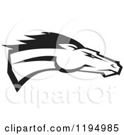 Clipart Of A Black And White Running Bronco Or Mustang Royalty Free Vector Illustration