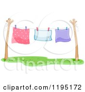 Cartoon Of Colorful Blankets Air Drying On A Clothesline Royalty Free Vector Clipart