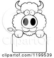Cartoon Of A Black And White Cute Buffalo Calf Over A Sign Royalty Free Vector Clipart