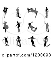 Clipart Of Black Silhouetted Skateboarders Royalty Free Vector Illustration by AtStockIllustration