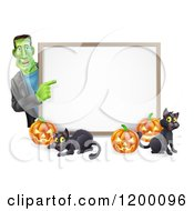 Cartoon Of A Happy Frankenstein With Cats And Halloween Pumpkins Around A White Sign Royalty Free Vector Clipart by AtStockIllustration